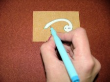 Place sandpaper under the fabric to prevent shifting and pulling while you are tracing around the freezer paper.